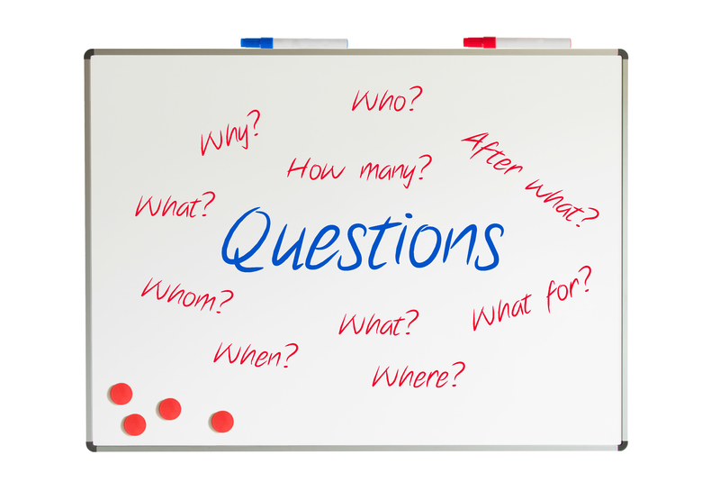 Questions on a whiteboard, isolated on white